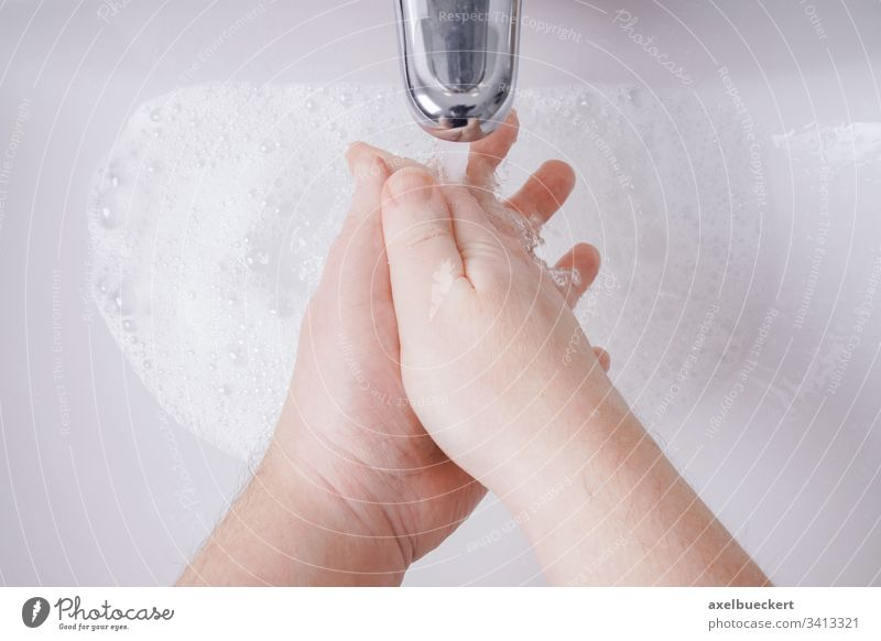 washing hands with soap and water from personal perspective hygiene sink basin bathroom health care clean sanitary healthcare closeup close-up unrecognizable