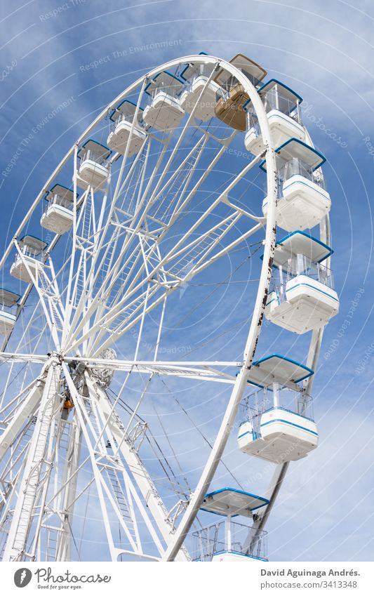 White fair ferris wheel on a sunny day Ferris wheel Blue Sky Clouds Sunlight Joy Leisure and hobbies Light Summer Happiness Exterior shot Party Holiday season