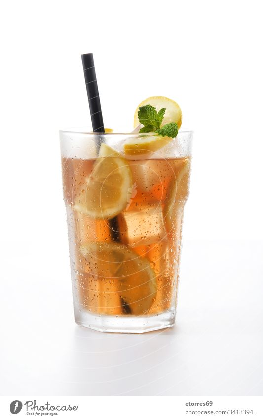Iced tea drink in glass with lemon isolated on white background beverage brown citrus cocktail cold fresh fruit ice ice tea liquid mint refreshment straw summer