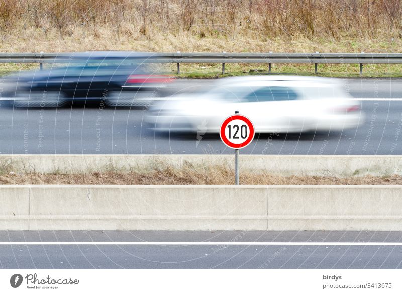 General speed limit of 120 km/h on German motorways, speed limit sign on motorway with moving traffic, moving cars in motion blur tempolimit Driving