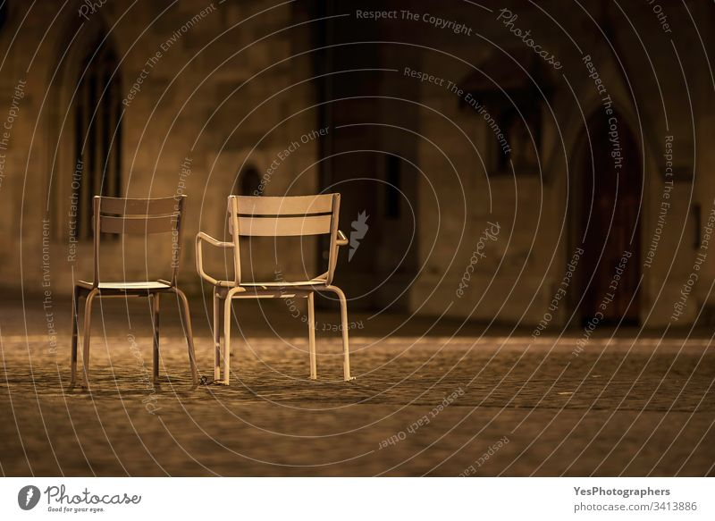 Two empty chairs on Zurich streets. Night scenery Switzerland abandoned city europe european metal night nobody old town open-air opera outdoor outside rest
