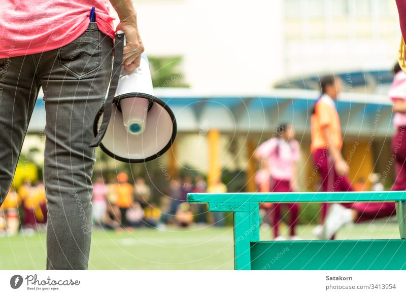 BANGKOK, THAILAND - January 15,2019  At the school's annual sporting event, Elementary student girls with their coach in the chair ball sports match young