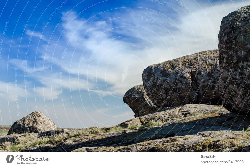 large stones against a blue sky and white clouds big big stones clear day gray mountain landscape mountains nature rocks summer sunny travel