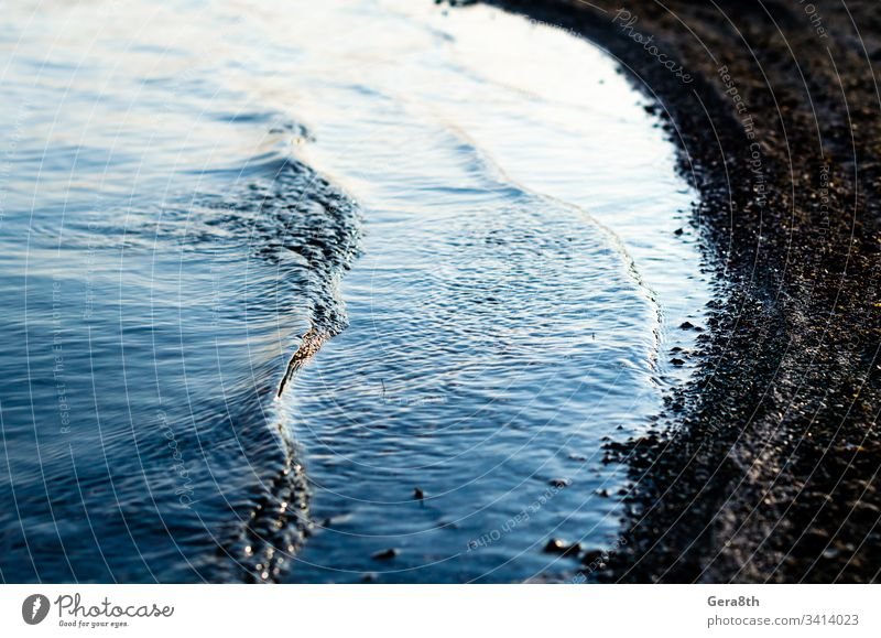 small waves near the lake shore closeup blue blue water natural nature pond river textural tide