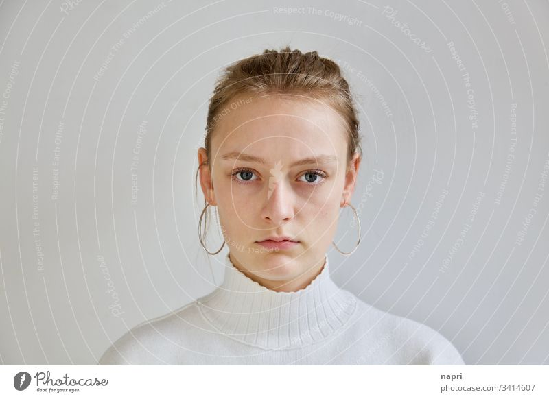 Portrait of a very pretty young woman with a natural look and stern gaze against a white background. Youth (Young adults) Young woman 18 - 30 years
