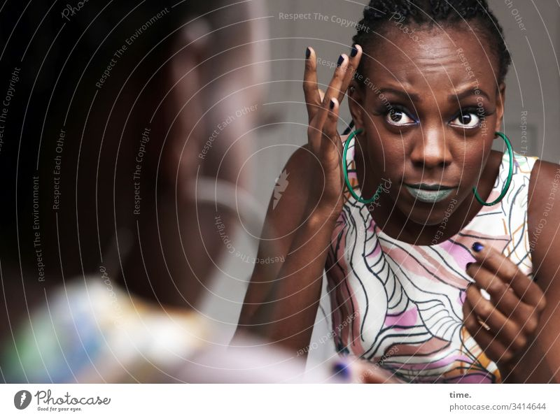 Tash especially Beautiful vigilantly daylight melanin Swarthy artist actress Observe look Looking Skeptical Feminine Front view portrait feminine Mirror