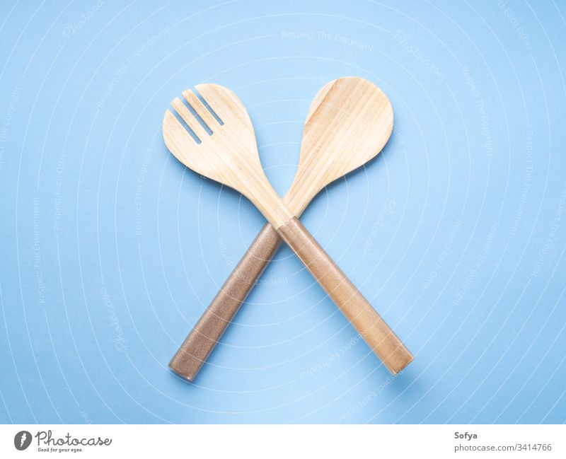 Minimal cooking, eating concept on blue fork spoon background food cutlery wood pastel color turquoise minimal abstract ban forbid meal lunch dinner light diet