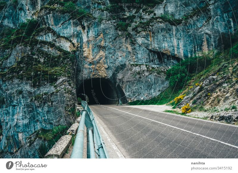 Natural bridge over an empty road natural mountain travel trip alone depth of field cave beautiful landscape wild nature outdoors cold cold tones risk road trip