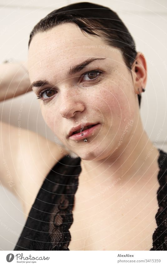 Portrait of a young woman in the shower lingerie Underwear Point Low neckline Femininity Copy Space right Copy Space left Forward Portrait photograph