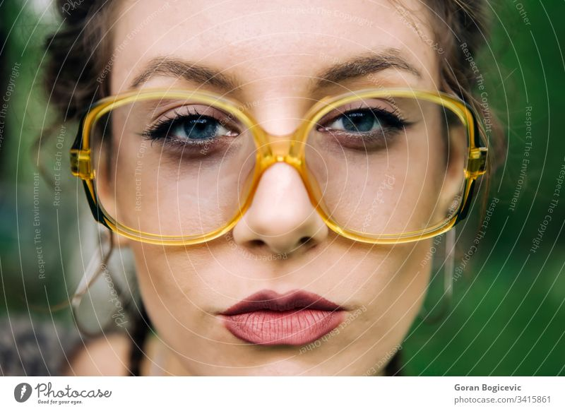 Portrait of young woman lips face female portrait beautiful glasses adult girl looking caucasian person pretty attractive expression eyewear closeup eyeglasses