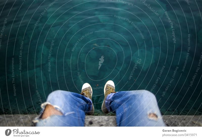 Man on the edge jeans danger dirty dusty foot footwear leather old pair risk shoes suicide two used vintage water torn