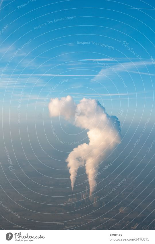 Aerial view of a power plant with cooling tower clouds in a blue sky aerial photograph power station Cooling tower Water steam Exhaust gas Smog Blue Sky