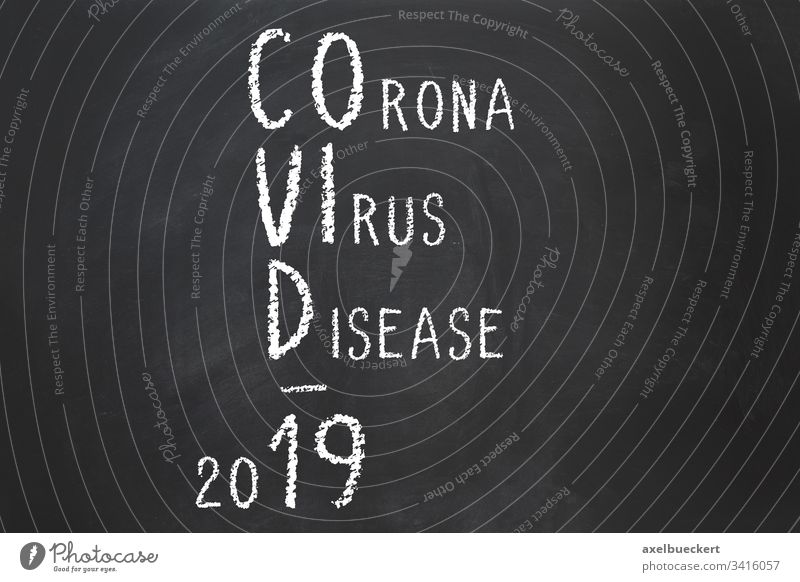 Corona virus disease Covid-19 acronym explained corona covid-19 coronavirus name abbreviation chalk text chalkboard blackboard explanation pandemic outbreak