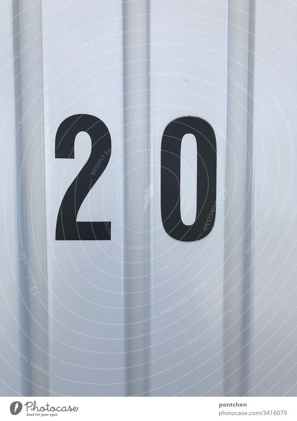 Black number 20 on corrugated iron garage door 2020 Corrugated sheet iron Garage door Colour photo Deserted Digits and numbers Copy Space top Copy Space bottom
