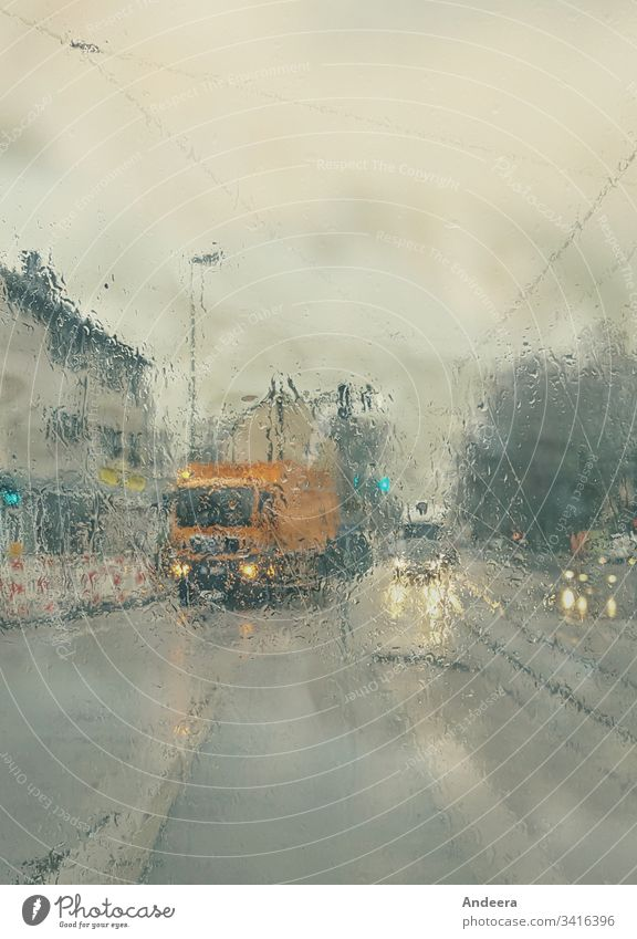 Blurred wet road with cars and bright headlights in rainy weather Rain Rainy weather Wet Street Sky Rainy sky Floodlight Light Lantern