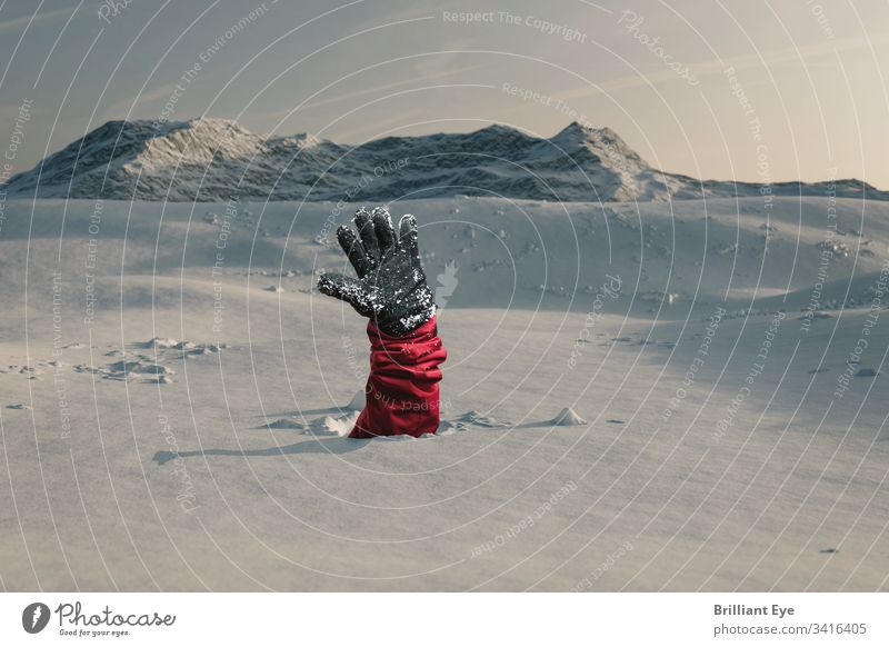 Hiker reaches out his snowy hand to signal help because of the avalanche. Concept Danger Avalanche Snow Hand skis Winter Blue White travel Landscape Ice Peak