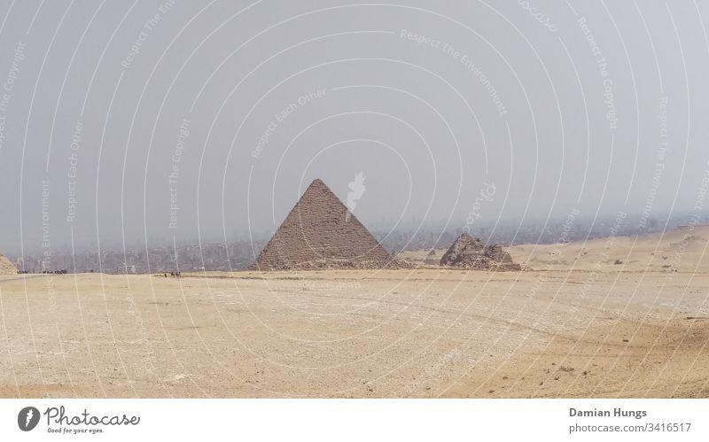 Pyramid before Cairo Desert; Cairo; Egypt Sky Giza Sand Exterior shot Pharaohs Landmark Architecture