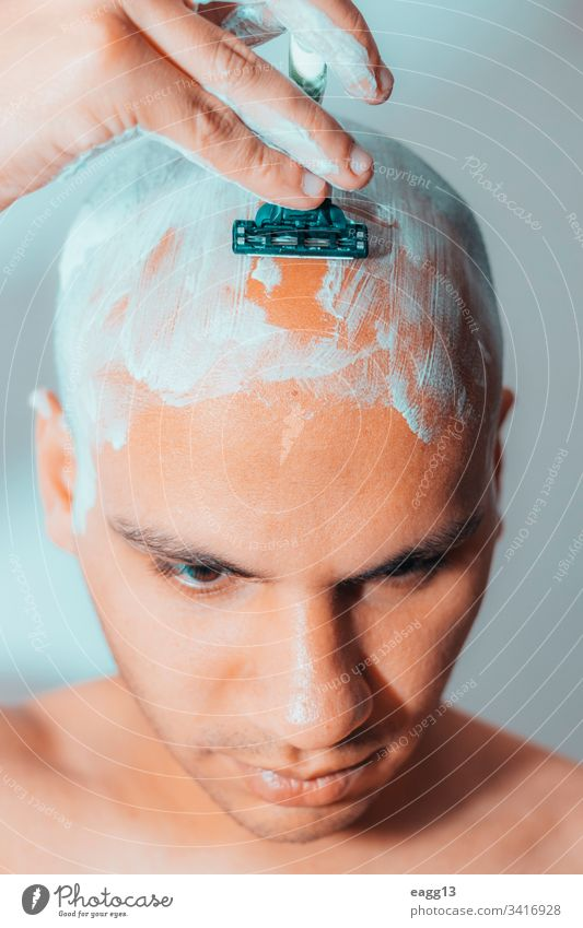 Man Shaving His Head Using White Foam appearance bald balding bath blade care concentration cropped depilation determination expressing eye face foam front guy