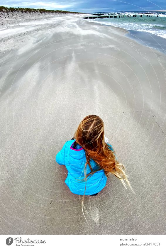 beach child Child Girl Beach Gale Baltic Sea Sand hair Blow Break water best Spring Crouch Observe Playing Freeze Waves Clouds Blue stormy Natural neat Pure