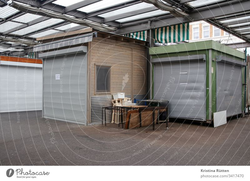closed market stalls Markets market stands Market stall booths Marketplace Closed too Roller shutter roller shutter shutters Closing time opening hours