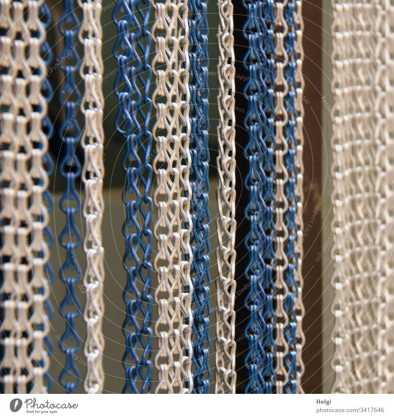 hanging white, grey and blue chains as a curtain on a door Chain Chain link chain curtain Drape Screening Hang Blue White Gray Metal Exterior shot Deserted