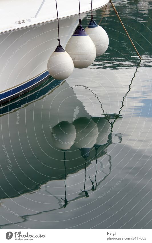 Detail of a ship with spacers and reflection in the water Navigation Exterior shot Harbour Maritime Watercraft Deserted Sailing ship Vacation & Travel Ocean
