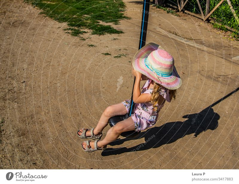 Little girl riding a zip line in the park activity adventure amusement amusement park brave child child playing childhood courage cute enjoy entertainment
