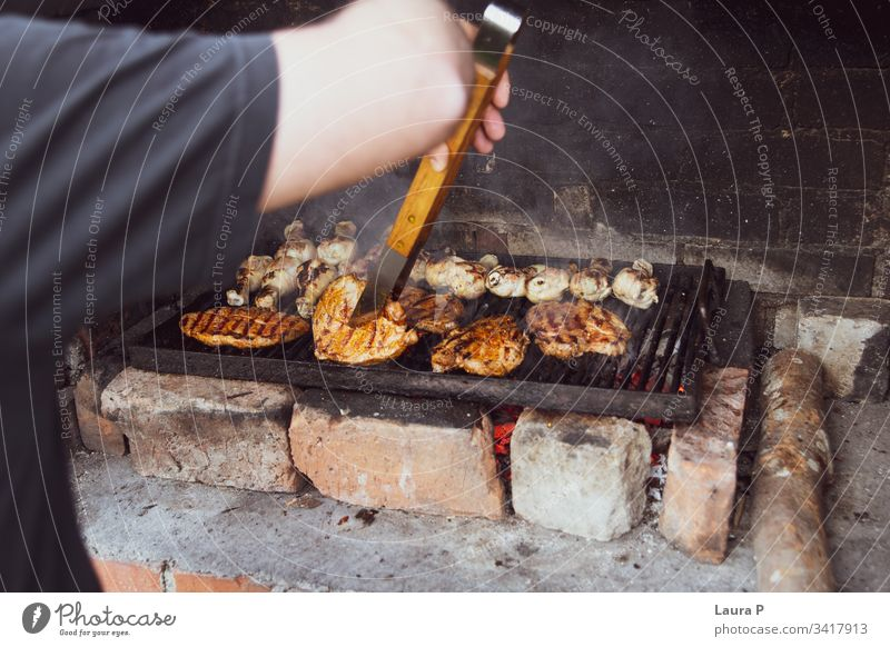 Close up of a man preparing a barbecue background barbecued barbecuing barbeque bbq beef black burn camping charcoal coals cook cooking dark dinner fire