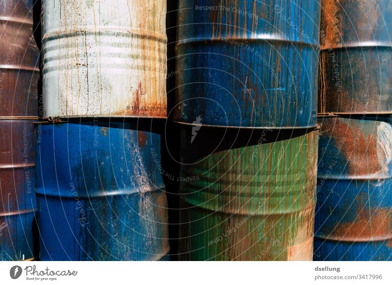Different barrels stacked to a wall Threat Environmental damage Part Dry Background picture Environmental protection Damage Crack & Rip & Tear Bizarre Gloomy