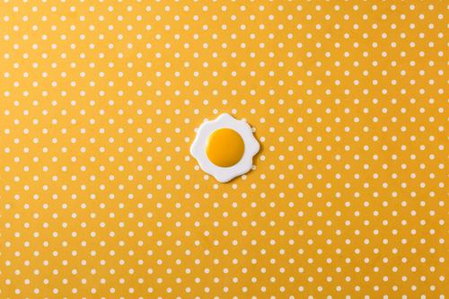 Minimalist fried egg on yellow background with white circles. Top view color concept cooked crockery diet food kitchenware minimalist nutrition object protein