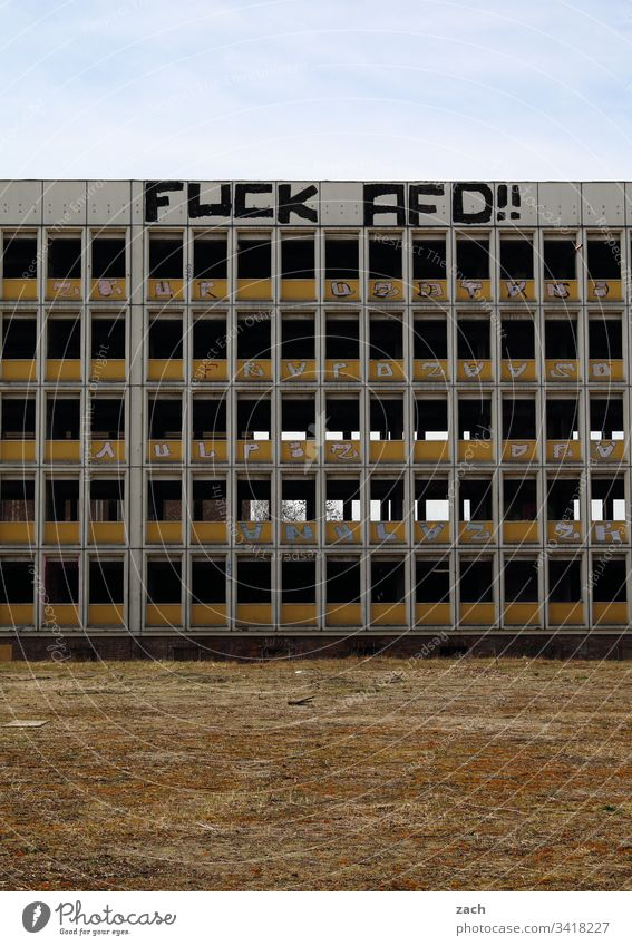 Ruin of a high-rise building in berlin with lettering Fuck AFD, graffiti Berlin AfD Politics and state Reichstag Germany Deserted Capital city Extreme
