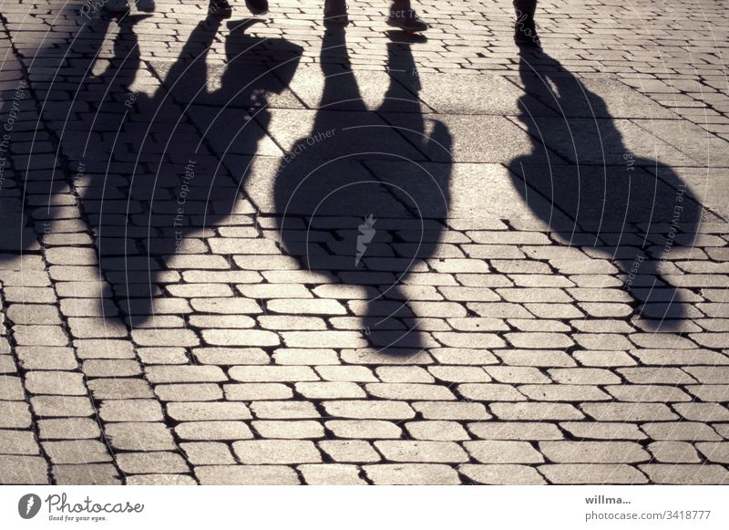 Shadow of a group of people. Where are the hamsters that people buy? persons Group four 4 city stroll Shopping trip To go for a walk Paving stone sunny