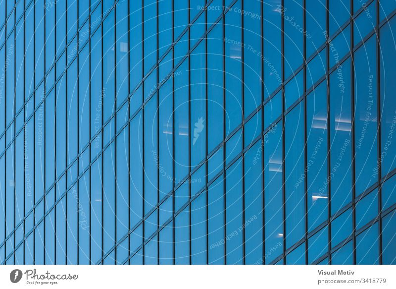 Glass facade of an office building windows architecture architectural architectonic urban metropolitan constructed edifice structure geometric geometrical