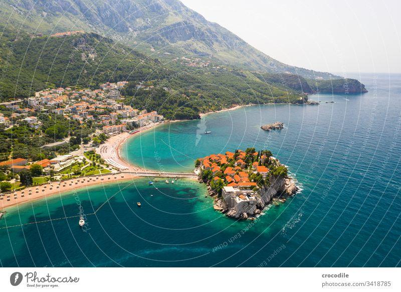 Small private peninsula on the coast of Montenegro Sveti Stefan Coast Ocean Vacation mood vacation travel Sightseeing Health Spa Beach Rock Sailboat Mountain