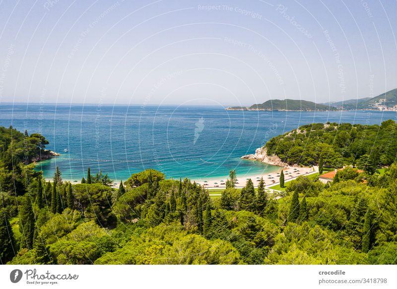 Hotel beach on the coast of Montenegro Coast Ocean Vacation mood vacation travel Sightseeing Health Spa Beach Rock Mountain Vacation & Travel Landscape Summer