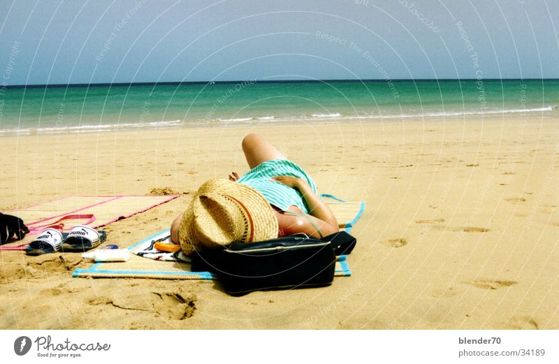 Lazy on the beach Canaries Fuerteventura Beach Woman Ocean Summer Physics Europe Sun Sunhat white sand pumpkins Warmth
