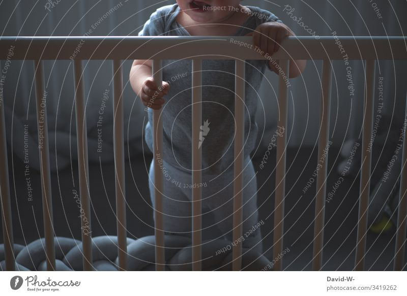 Child in crib is awake and crying Cot Alert cries screams Awakened Toddler Baby Crib Scream Cry Grating penned Emotions emotionally by oneself Lonely Fear shout