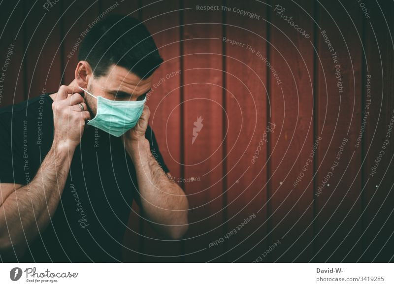 Coronavirus man with breathing mask coronavirus Respirator mask epedemia worst case Mask Mouth Quarantine karantäne Precuation Fear point interdiction Virus