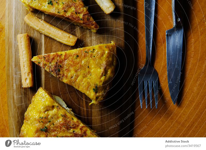 Fresh piece of tasty pie on table slice omelet spanish potato dish baked golden wooden food delicious meal fresh cuisine rustic board organic lunch homemade