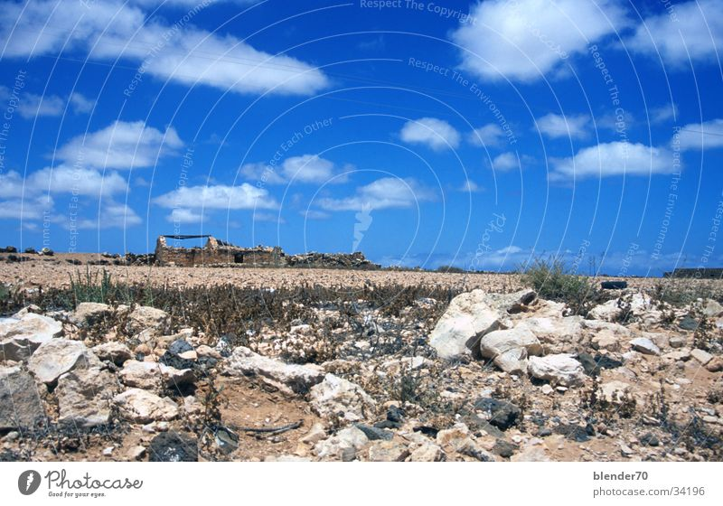 Ruin on the horizon Horizon Gravel Badlands Loneliness Drought Fuerteventura Canaries Wide angle Europe Stone Sky Blue Desert