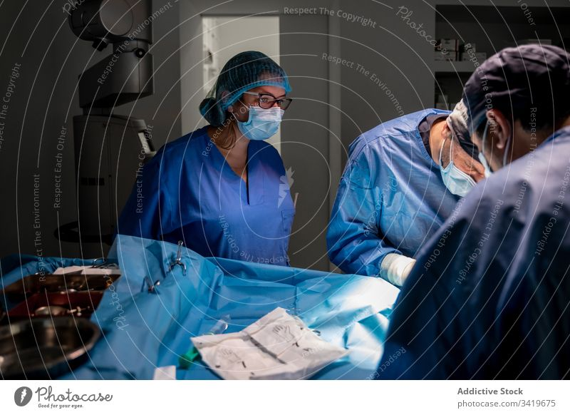 Medical staff during surgery in modern clinic surgeon hospital medic medicine doctor treatment surgical nurse work medical practitioner people specialist