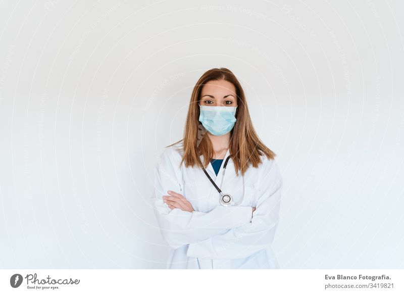 portrait of doctor woman wearing protective mask and gloves indoors. Corona virus concept professional corona virus hospital working infection safety epidemic