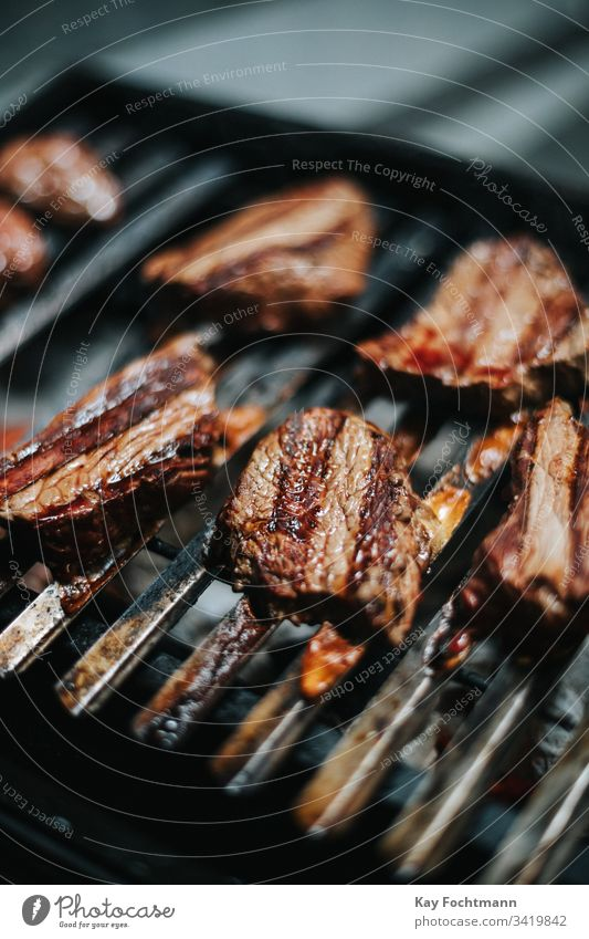 delicious steaks on a barbecue grill barbecuing barbeque bbq beef cooking dinner food grid grilled grilling heat hot meal meat nutrition outdoors party portion