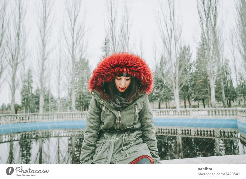 Young cool woman with ghotic style in an urban place city winter clothes goth rock modern casual wear trendy coolness fresh freshness youth outdoors park