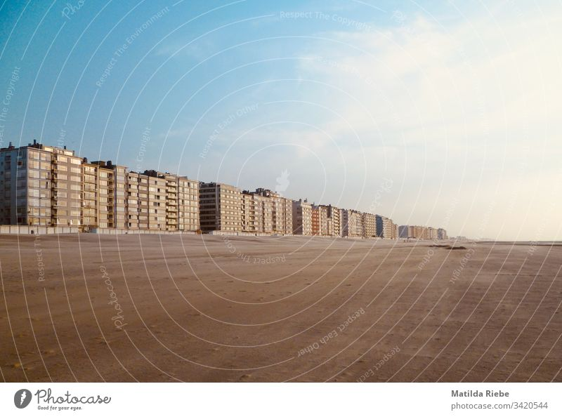 Row of houses on the beach Beach House (Residential Structure) Sand wide Far-off places Empty Coast Horizon Vacation & Travel Deserted Exterior shot Summer