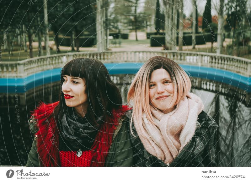 Two young and casual women spending time together friends trendy youth friendship two urban outdoors funny enjoy life lifestyle youthful fresh real candid