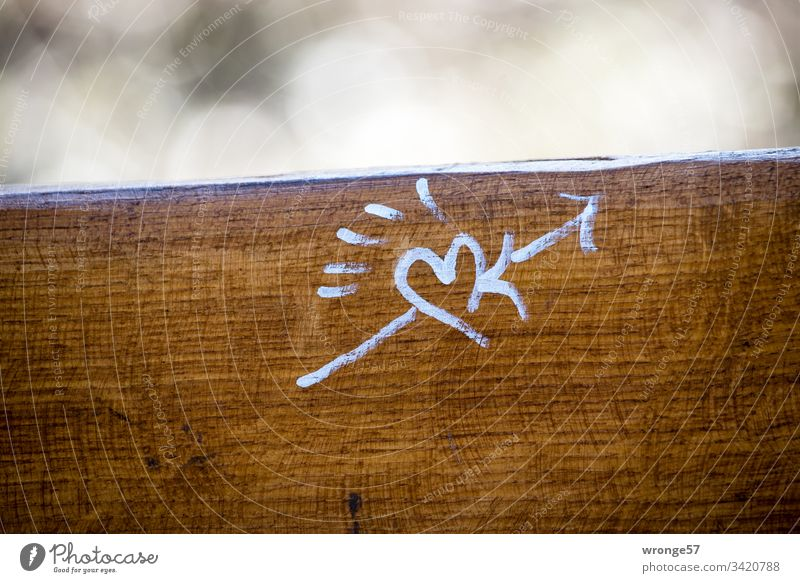Heart and Cupid's arrow drawn with white pencil on the back of a park bench Sign Arrow Love Colour photo Deserted Day Infatuation Exterior shot Romance Emotions