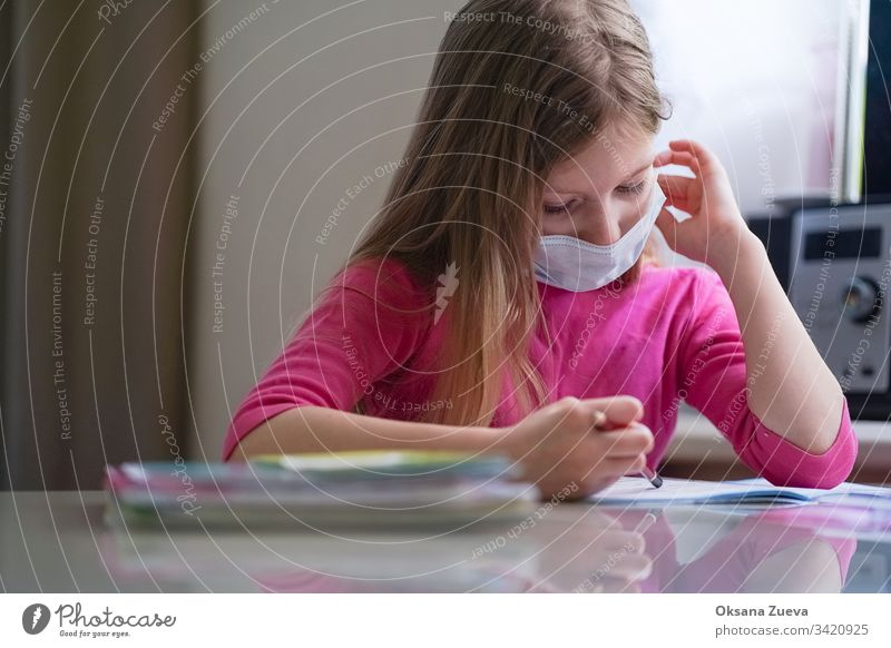 Coronavirus home school concept, quarantine. Girl doing homework. academic background book caucasian child childhood class computer coronavirus course cute