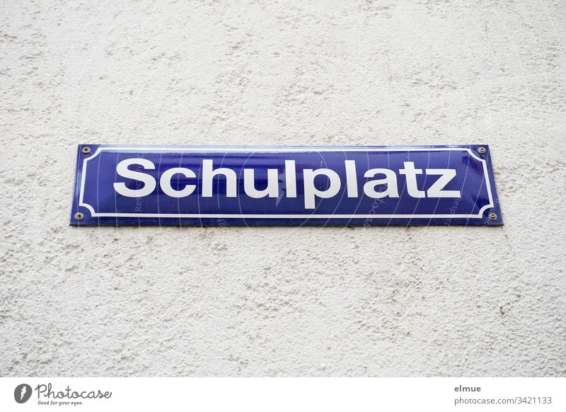 "Sign ""Schulplatz"" sign street sign School place Wall (building) Communication Name writing designation Reading Places Wall (barrier) Enamel sign Exterior shot"