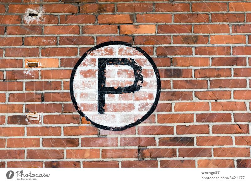 Large black P on white background on a brick wall Letters (alphabet) Colour photo Day Characters Exterior shot Capital letter sign Brick wall Building